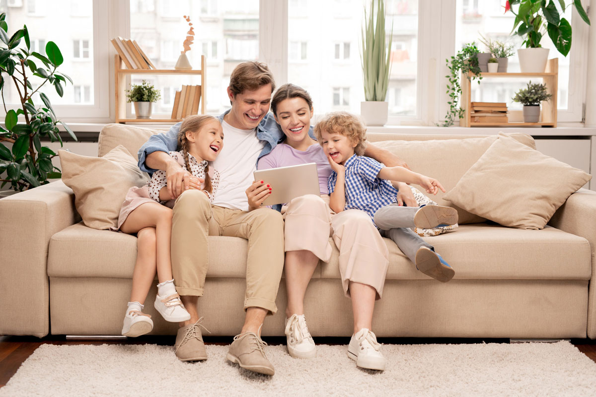 Home Comfort Connect - Heaters - Family on a Couch